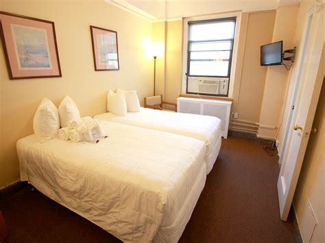 2 twin beds standard room two twin beds half bathroom nyc budget rooms