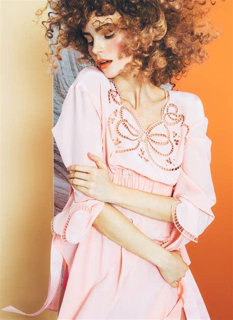 Oita Blouse juju ivanyuk sports a curly hairstyle in italia