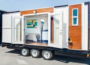 man converts shipping container into tiny home on wheels