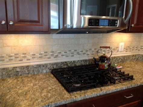 granite kitchen backsplash here is a backsplash to go with juperano giallo granite counter tops when selecting tile to go