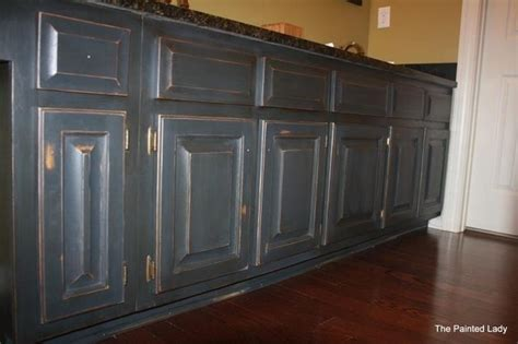 painted distressed and waxed gray cabinets