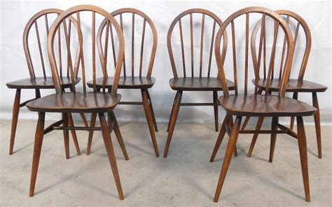 set of six stickback elm dining chairs by ercol sold
