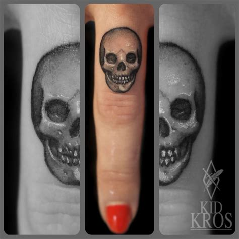 skull finger tattoos skull finger enngraved tattoos