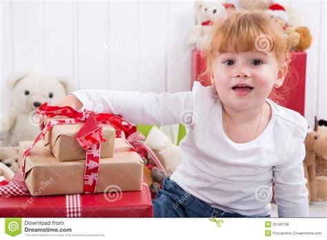 young girl  christmas presents  teddy bears  background stock photo image