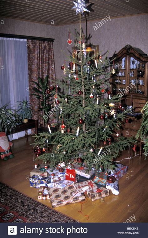 most popular live christmas trees of 1960s 1960s tree surrounded with gifts in common swedish living stock photo royalty free