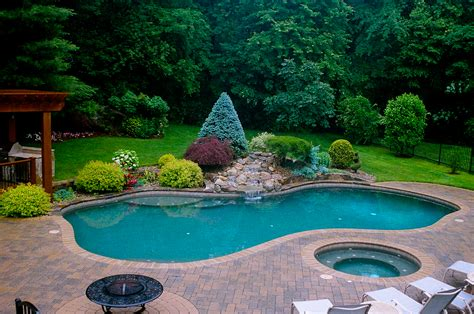 pool landscapes poolside waterfall with formal planting 2