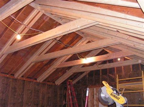 raising basement ceiling opening up the attic to increase ceiling height and sense