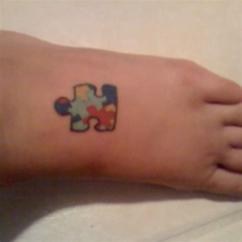 puzzle pieces tattoo autism puzzle tattoos