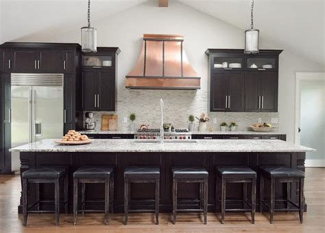copper kitchen cabinets copper french hood with curved gray mosaic tile backsplash