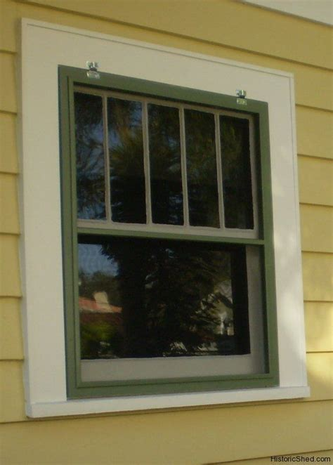 wood window screen   historic bungalow  st petersburg florida yellow  white