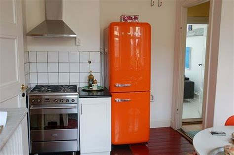 Refrigerator For Small Kitchen by Small Kitchen With An Orange Smeg Refrigerator Gorgeous
