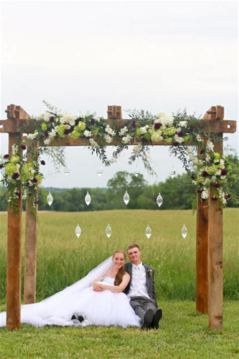 Decorating a rustic wood arch for a wedding   Google