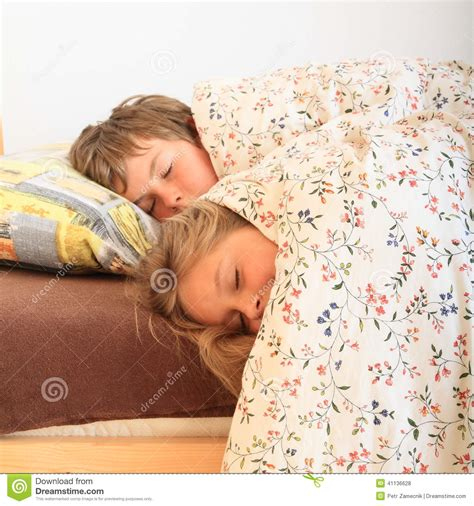 girl lying bed with flowers sleeping kids stock photo image of bedroom tired