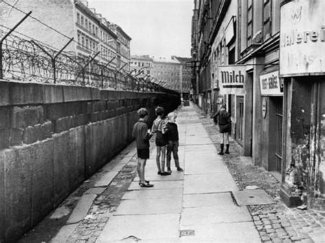 the berlin wall, separating west berlin and east berlin