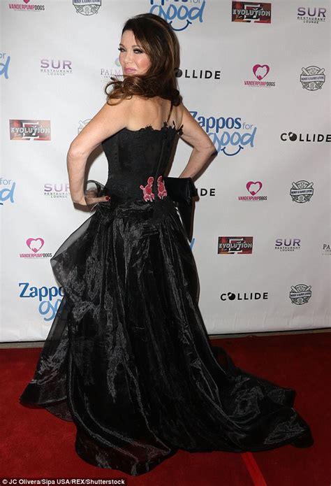 lisa vanderpump pink top with black bow lisa vanderpump turns heads in dramatic poodle print gown