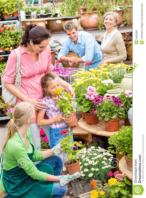 family garden center family garden center shopping for flowers stock photo