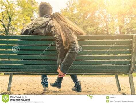 lovers on a park bench couple in love on a bench stock photo image 45689374