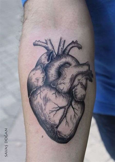 human heart tattoo design on forearm shortlist