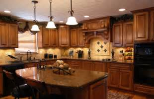 hanging pendant lights look stunning over this dark wood kitchen brighten the island