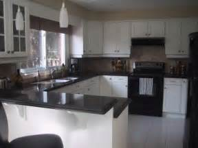 Kitchens With White Cabinets And Black Appliances Kitchen With White Cabinets And Black Appliances Counter For The Home Cabinets