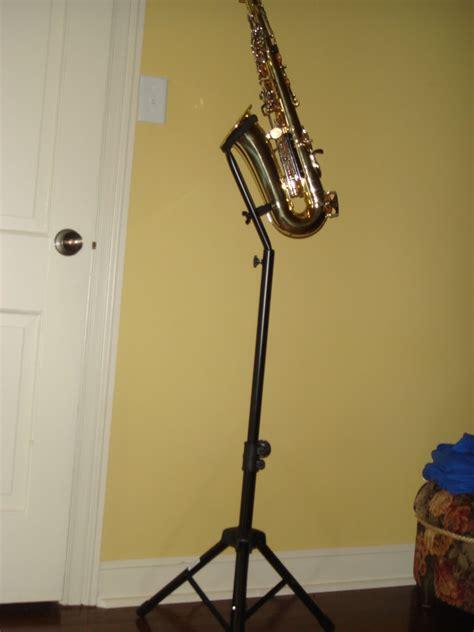 saxtastic saxophone  stage stands tall altotenor sax