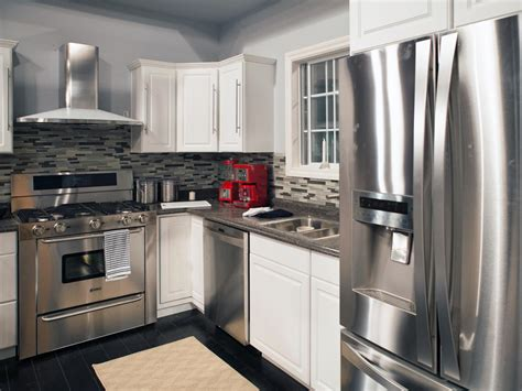 kitchens with stainless steel appliances stainless steel appliances dark gray countertops and a