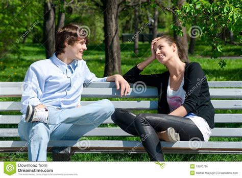 couple sitting on bench couple sitting together on park bench royalty free stock