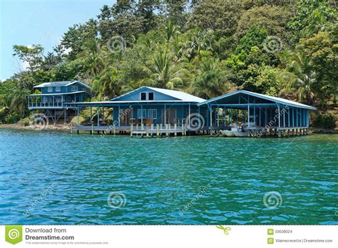 house over water caribbean home and boat house over the water stock photo