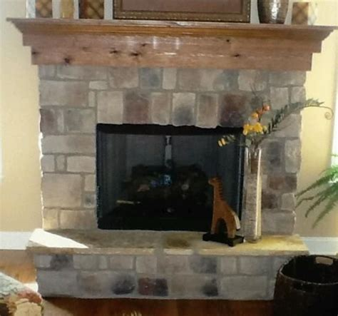 stone and cedar wrapped fireplace construction zone