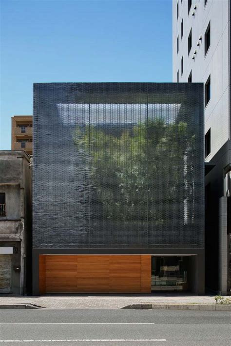 Glass Front House by Cool And Peaceful House With Optical Glass Facade