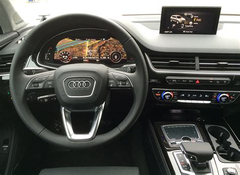 audi suv q7 interior 2017 audi q7 suv proves slick and opulent consumer reports