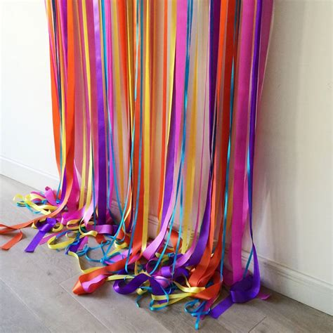ribbon drapes rainbow bright wedding backdrop by just add a dress
