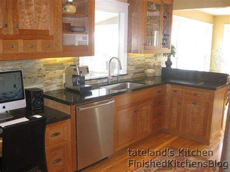 ubatuba granite and stacked backsplash kitchen