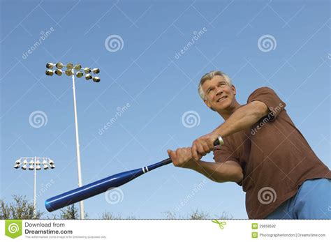 swinging baseball bat man swinging baseball bat outdoors stock photo image