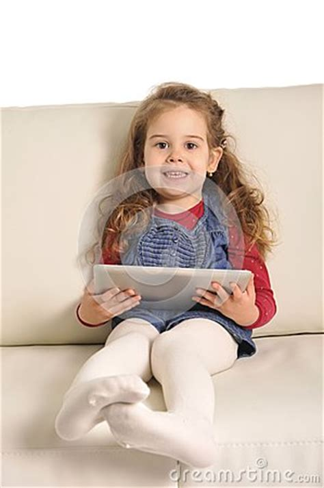 little girls sofa sweet little girl lying on couch playing with digital pad royalty free stock image image 38253196