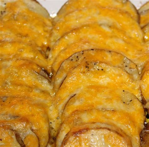 Reader Recipe Cheesy Baked Potatoes by Cheesey Potato Bake Discover More Ideas About Cheesy