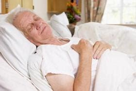 old man in bed ideal postures for sleep prone supine or left right side