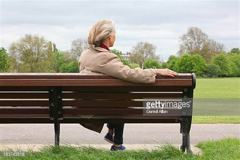 sitting on bench park bench stock photos and pictures getty images