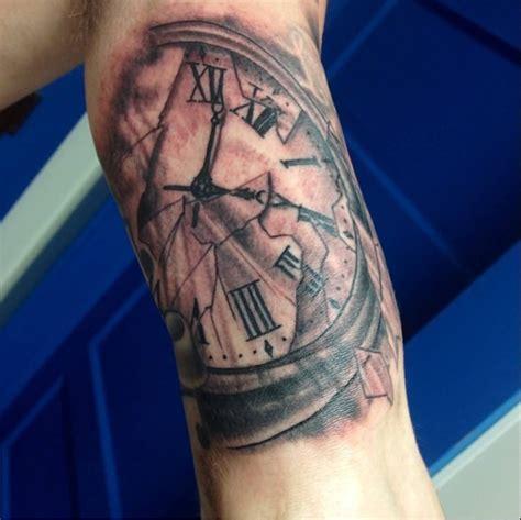 tattoos on bicep grey skull and clock on inner bicep