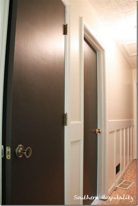 black doors in hallway
