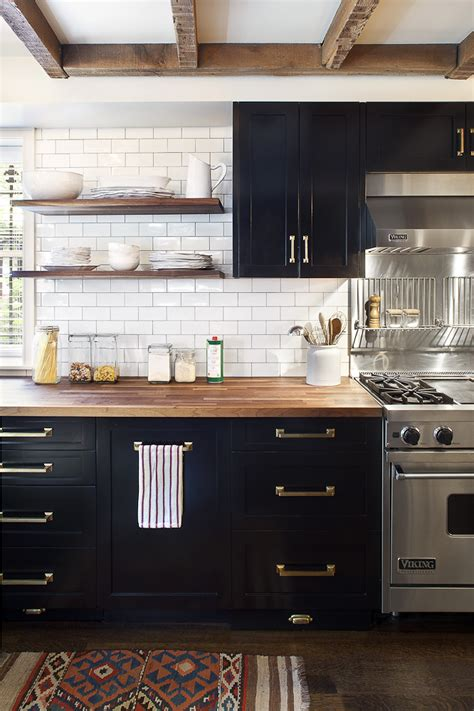 kitchen with black cabinets brass hardware commercial