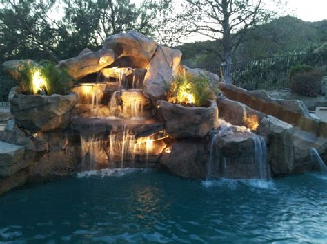 rock waterfalls for pools rock waterfalls with slide added to swimming pool yelp