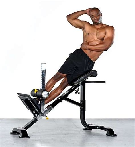 back raise bench side bends on a hyperextension bench bodybuilding wizard