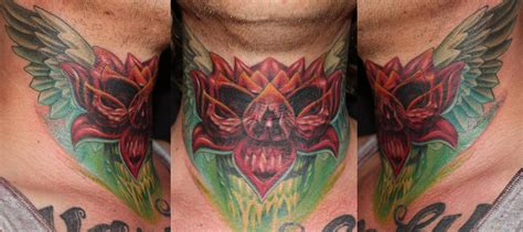 tattoo neck piece two images in one custommade neck piece by dennis wehler