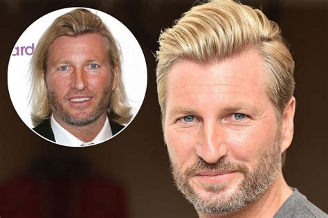 sevarge haircut revealed robbie savage s new haircut as ponytail is