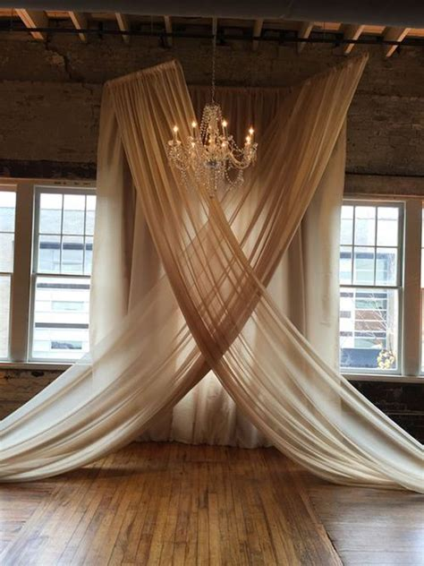 Wedding Backdrop With Chandelier by These Chandelier And Chiffon Wedding Ceremony Backdrops