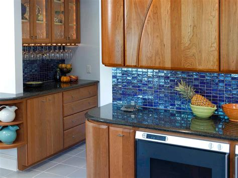 glass backsplashes for kitchens blue tiles kitchen backsplash with wooden cabinets and