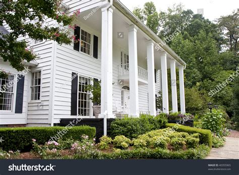 white colonial house columns stock photo 40355965