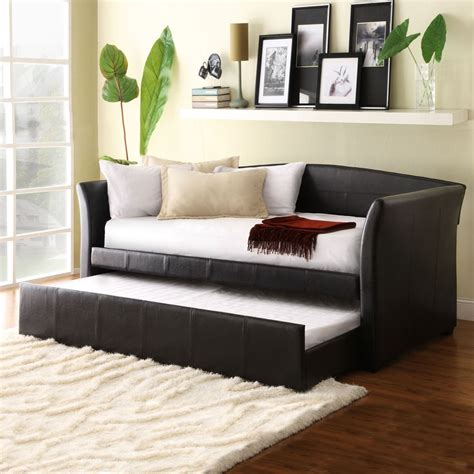 Sofa In Small Living Room Maximizing Small Living Room Spaces With Black Leather Sleeper Sofa And White Cushions Plus Fold