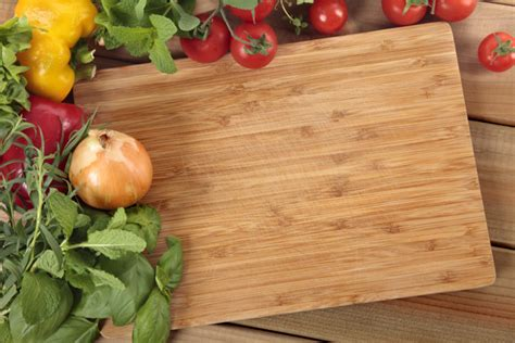 Fast Food Cutting Food vegetables with a chopping board photo free